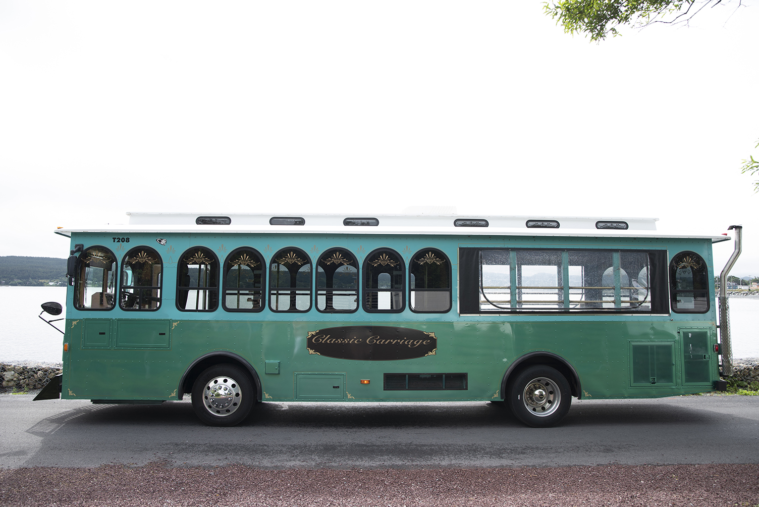 Classic Carriage green trolley, Tour Bus NL, Bus Transportation Newfoundland, St. John's tours